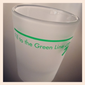 "j street's ""fill to the green line"" shot glass; photo by salem pearce via  instagram"
