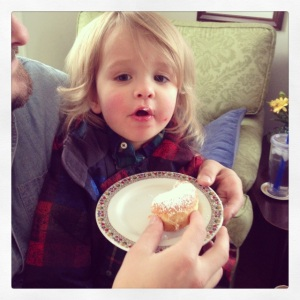 a gratuitous photo of my nephew, who also recently turned two, eating his first sufganiyah; photo by salem pearce via instagram