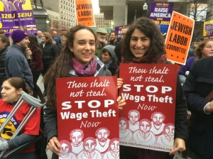 "emily and helen, with signs from interfath worker justice, at ""fight for 15"" rally in downtown boston; photo by salem pearce"
